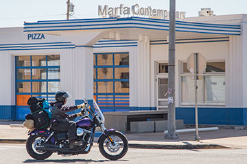 Biker passing through Marfa.